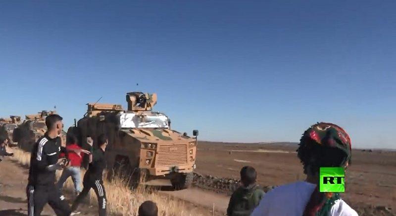 Syrians stoning Erdogan Forces