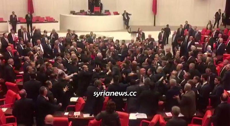 Turkish Parliament MPs fight over Erdogan intervention in Idlib